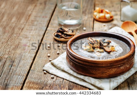 White bean mushrooms soup with croutons. toning. selective focus - stock photo