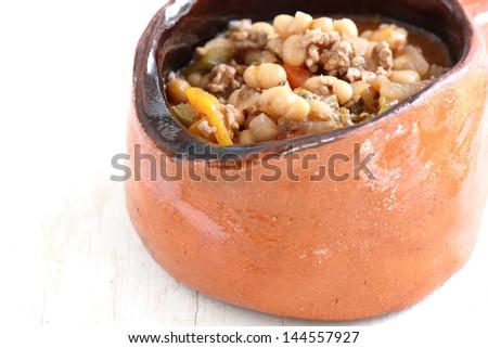 white bean soup in a pot - stock photo