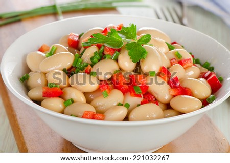 White beans salad  in   a  bowl. Closeup. Selective focus - stock photo
