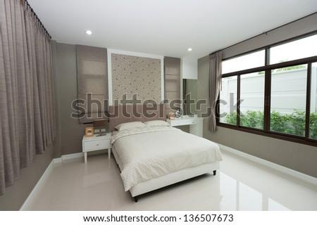 White bedroom with big window - stock photo