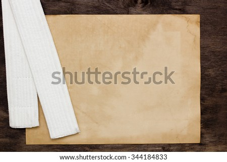 White belt karate - the initial training level. Sheet old paper for information. - stock photo