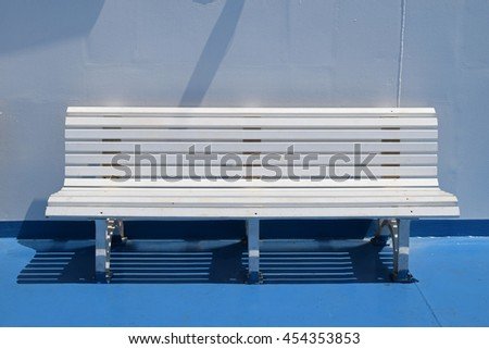 White bench on ferry boat cruise ship deck. Summer travel background. - stock photo