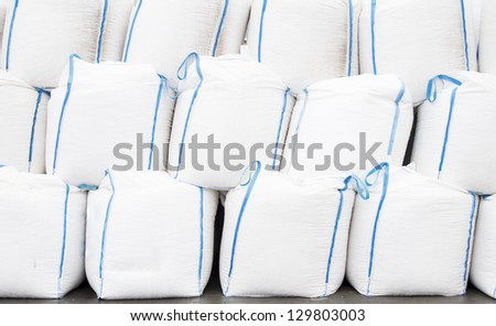 White big bags with goods - stock photo