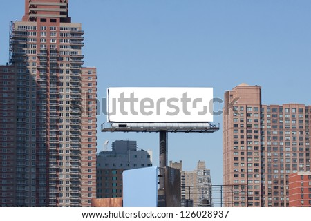 White big Billboard in city. Two red bricks high buildings. - stock photo