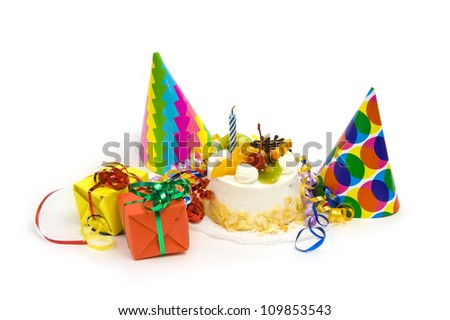 White birthday cake with fruit and blue candle - stock photo