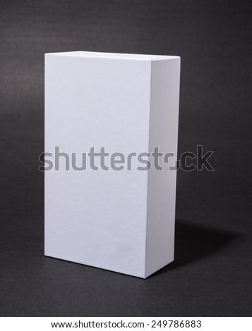 white blank cardboard box on grey background - stock photo