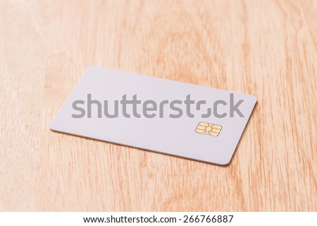 White blank credit card on wood board. - stock photo