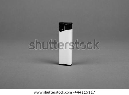 White blank gas lighter mock up stand. Empty surface cigar lighter. Lighter template mockup. Cigarette lighter template. - stock photo