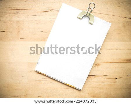 White blank note paper and clipped on wood background - stock photo
