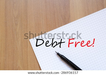 White blank notepad on office wooden table Debt free concept - stock photo