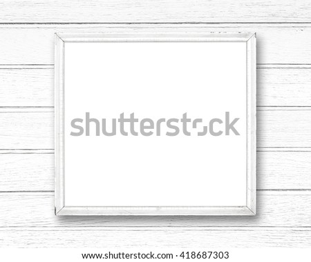 White blank old picture frame on white wood wall. - stock photo