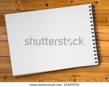 White blank page sketch book on wood table - stock photo