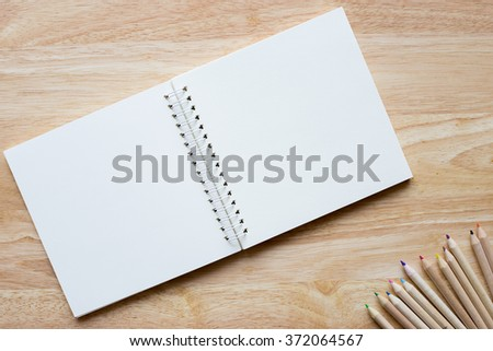 White blank pages on wood table. - stock photo