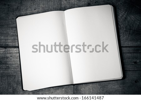 White blank pages sketch book on wood table vertical   - stock photo