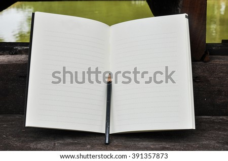 White blank pages sketch book on wood table vertical,blank spiral notebook and pencil on dark wood background - stock photo