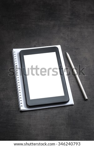 White blank screen on the tablet pc on wooden background, close up - stock photo