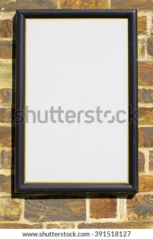 White blank sign on a stone wall. - stock photo