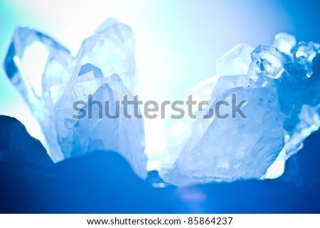 white blue shining rock mountain crystall quarz - stock photo