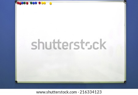 White board in blue wall background, isolated - stock photo