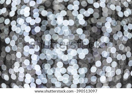 White bokeh lights on black background - stock photo