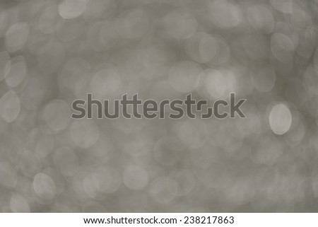 White bokeh on abstract light background - stock photo