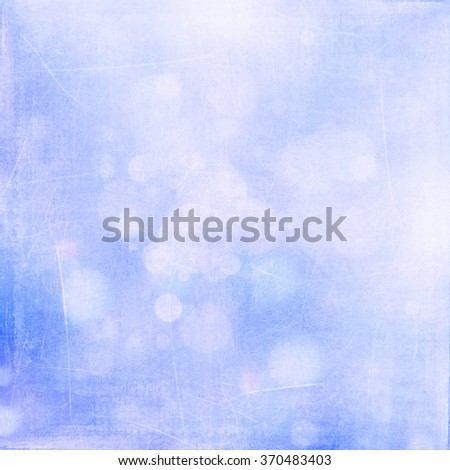 White bokeh on bright blue grungy background - stock photo