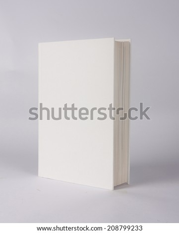 white book showing white front cover on a grey background - stock photo