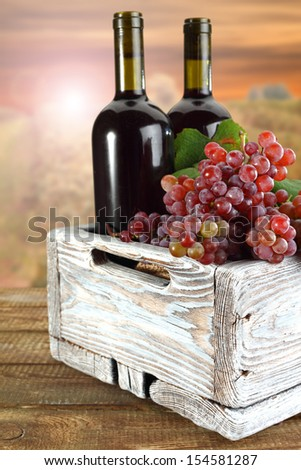white box of wine and grapes  - stock photo
