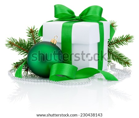 White box tied green ribbon bow, pine tree branch and christmas ball Isolated on white background - stock photo