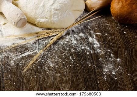 White bread drought and flour on kitchen table - stock photo