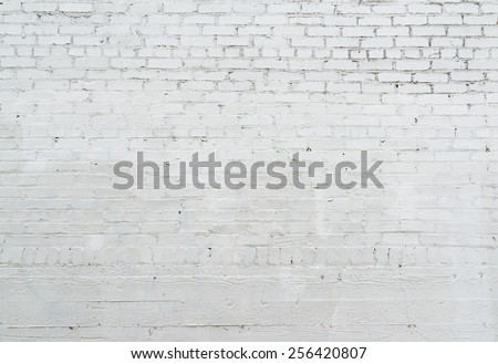 white brick wall, close up, with stucco,Ready for product display montage. - stock photo