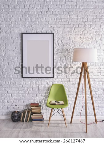 white brick wall in front of books and chairs - stock photo