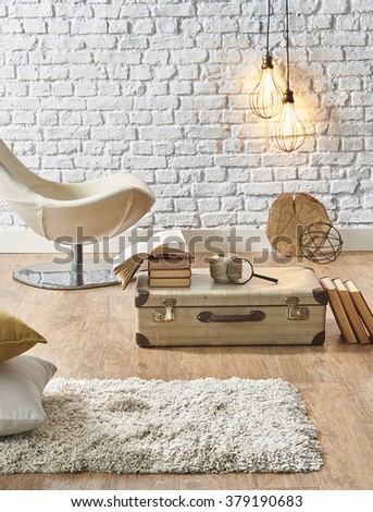 white brick wall interior white armchair and suitcase - stock photo