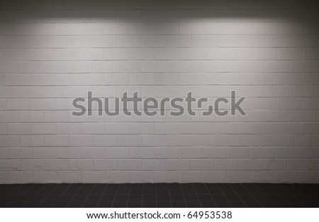 white brick wall pavement with dim lighting - stock photo
