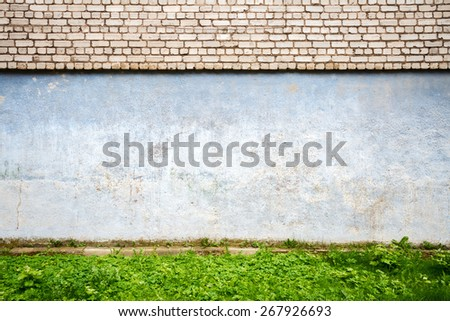 White brick wall with green grass   - stock photo