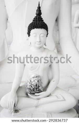 White buddha statue at Nakhonsawan province, Thailand. - stock photo