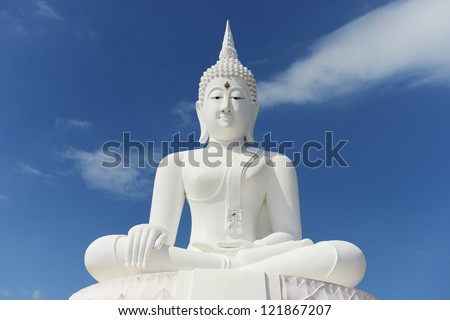 White buddha status on blue sky background - stock photo