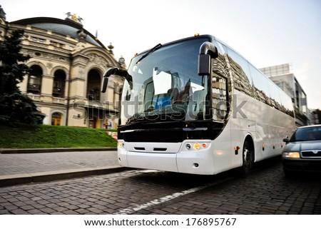 White bus on the road - stock photo