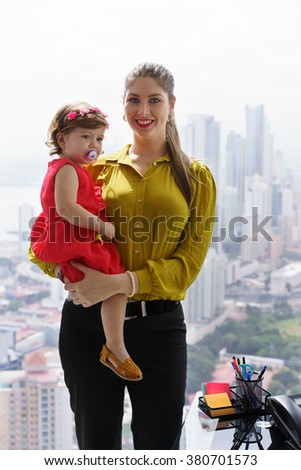 White businesswoman with little daughter in office. The executive mom spends time with her child and takes her at work - stock photo