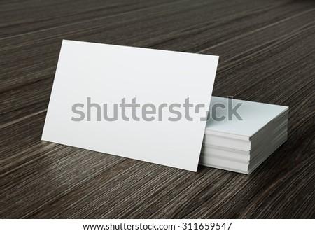 white bussiness card mockup on wood background - stock photo