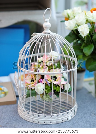 White cage with flowers as decoration on wedding  - stock photo