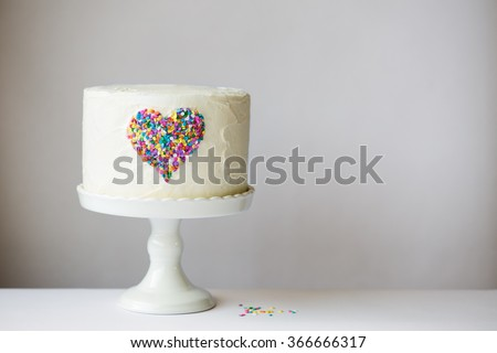 White cake with colorful heart - stock photo