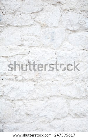 White calcareous stones wall texture abstract, bright wall surface detail background in vertical orientation, nobody. - stock photo