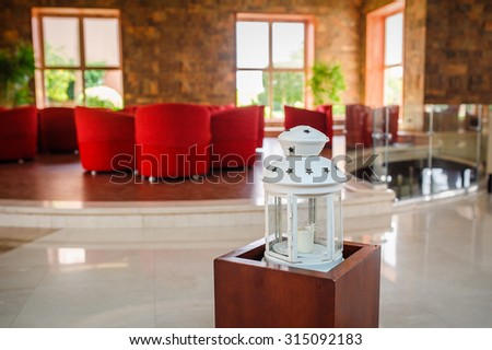 white Candlesticks as interior decoration on wooden table - stock photo