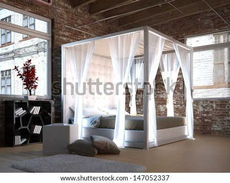 White canopy bed in a loft with brick wall - stock photo