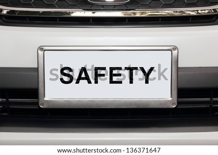 white car from front view  with safety white number plate - stock photo