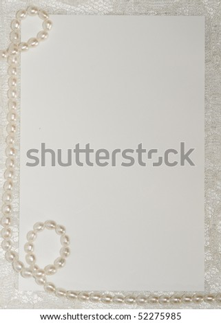 White card for congratulation on a background from lace - stock photo
