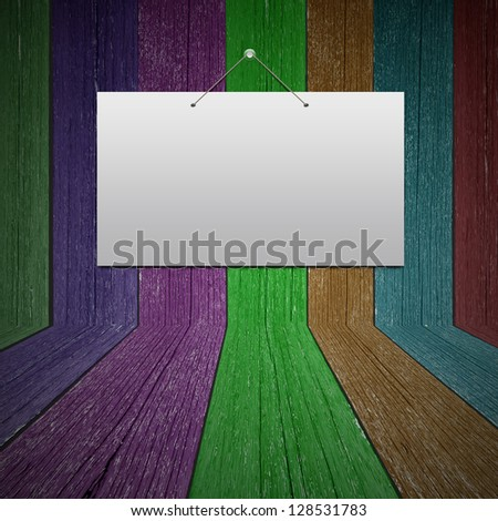 White card on wood wall in the room - stock photo