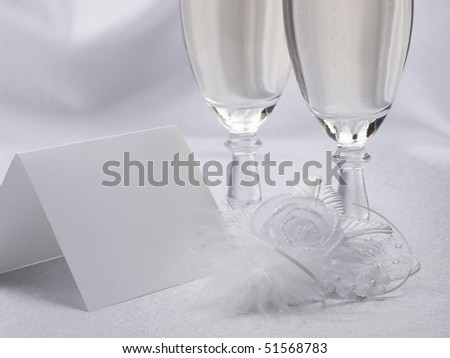 White card, wedding flowers from silk on a background from  satin - stock photo