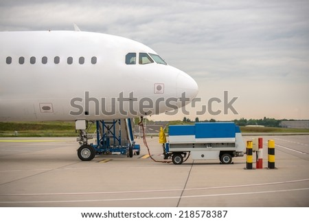 White cargo plane at airport refueling station - stock photo